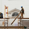 JIM VAIKNORAS/Staff photo. Over two years of work on renovation of the First Religious Society's church and steele, also known as the Unitarian Church. Workers remove scaffoling from the Unitarian Universalist Church on Pleasant Street in April of 2016.