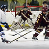 BRYAN EATON/Staff photo. Newburyport's Matthew Donlan tries to block a shot by Triton forward Dylan Leavitt.