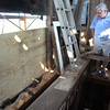 BRYAN EATON/File photos. Over two years of work on renovation of the First Religious Society's church and steele, also known as the Unitarian Church. Bill Heenehan shows a rotted girt during a tour of the Unitarian Universalist Church steeple in September of 2015. The girt will have to be repaired instead of replaced.