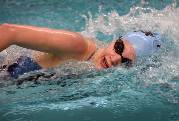 BRYAN EATON/Staff photo. Triton's Maggie Summit in the 100 freestyle.
