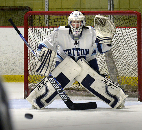 BRYAN EATON/File photos. Triton hosts Lynnfield. Triton goalie Ben Fougere is poised for a shot on net.