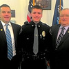 JIM SULLIVAN/Staff photo. Detective Sean Leary, Officer Liam Leary and retired Detective Joe Leary at Liam's swearing in ceremony Thursday.
