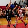 JIM VAIKNORAS/Staff photo Amesbury'sJulia LaMontagne drives to the basket against North Reading  during their game at Amesbury High School Friday night.
