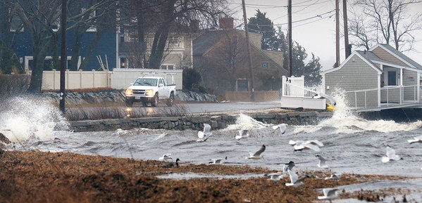BRYAN EATON/Staff photo. Waves in the Merrimack River splash onto Water Street in Newburyport during Monday's storm. Without a full moon in the weather equation, the tides weren't that high.