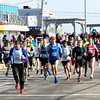 JIM VAIKNORAS/Staff photo  Runner take off at the start of the Hang Over Classic at Salisbury Beach Center Sunday morning.