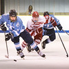 BRYAN EATON/Staff photo. Triton's Jed Cutter moves the puck with Masconomet right wing Dylan Campbell in pursuit.