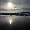 BRYAN EATON/Staff photo. Clouds move in to cover the sun reflecting in the Merrimack River in a view of the Route One Gillis Bridge with Newburyport in the back. The cloud cover is ahead of Tuesday's forecast of rain with temperatures in the low 40's.