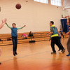 BRYAN EATON/Staff photo. Youngsters scrimmage in a game of basketball after learning basic moves and techniques over the past couple weeks. The lessons are one of several activities in the afterschool program Explorations at Salisbury Elementary School on Monday.