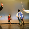 BRYAN EATON/Staff photo. Amesbury High School production of the Three Musketeers. Morgan Holmes, left, as a guard with Chris Marrama as D'Artagnan and others in a sword battle.