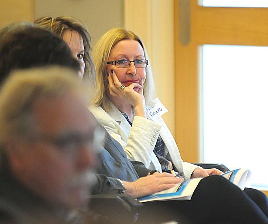 JIM VAIKNORAS/Staff photo  Newburyport School Superintendent Susan Vaccaro listens at a budget workshop at the Senior Center in Newburyport Saturday morning.