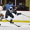 BRYAN EATON/Staff photo. Newburyport's Patrick Leary moves in as Triton's Mike Beevers shoots down the rink.