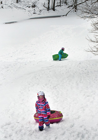 BRYAN EATON/Staff photo. Ella Peddie, 6, right, and her friend Sophia Davis, 7, both of Newburyport sled on the High Street side of March's Hill area Wednesday afternoon. There were not many sledders on the actual hill and the bottom of that area, which was all ice, some of which can be seen through the snow in the back of photo.