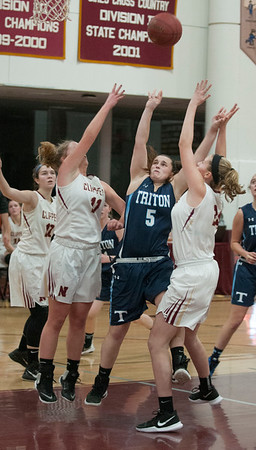 JIM VAIKNORAS/Staff photo  Triton's Bridget Sheehan shoots over a double team at Newburyport Friday night.