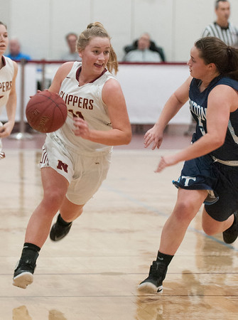 JIM VAIKNORAS/Staff photo Newburyport's Katelyn Haddendrives to the basket against Triton at Newburyport Friday night.