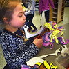 BRYAN EATON/Staff photo. Maggie King, 6, cuts out her painting of a pony princess from the story My Little Pony on Tuesday afternoon. She was in the Newburyport YWCA's Afterschool program at the Bresnahan School.