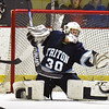 BRYAN EATON/Staff photo. Triton goalie Ben Fougere reaches out for the save.