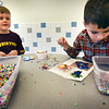 "BRYAN EATON/Staff photo. AJ Scrupps, 7, left, and Patrick Bavaro, 6, create characters from Pokemon like ""Froakie"" and other from beads onto cutouts. They were in the YWCA Afterschool Program at the Bresnahan School on Wednesday afternoon."