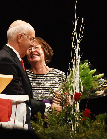 BRYAN EATON/Staff photo. Amesbury Mayor Ken Gray and his wife, Donna, are surprised by a bouquet of flowers after his swearing in ceremony.