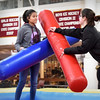 BRYAN EATON/Staff photo. Alx McDermott, left, and Lily Salka, both 15, try to knock each other off a pedestal in the inflatable jousting event.