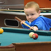 BRYAN EATON/Staff photo. Sean Choquette, 7, of Amesbury takes careful aim during a game of pool at the Boys and Girls Club in Salisbury on Wednesday afternoon. The club is closed today due to the storm.