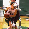 BRYAN EATON/Staff photo. Pentucket's Nathan McGrails is fouled by Rockport forward Noah Rawson.