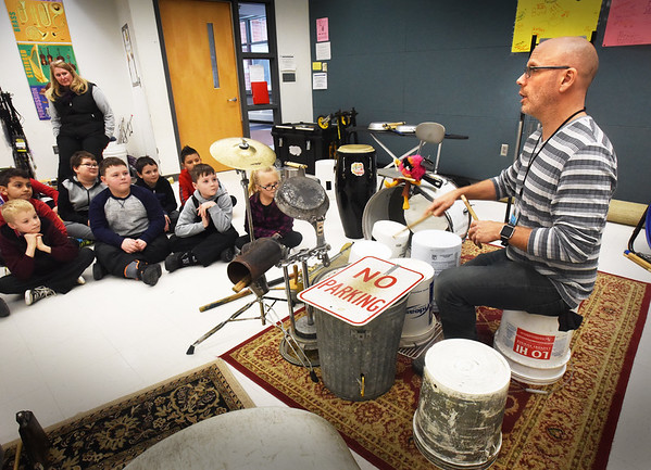 BRYAN EATON/Staff photo. Jeff Erwin of Trashcan Lid Productions demomstrates various instruments he has repurposed from items suchs as various tubs, frying pans, stove pipes, ironing boards and so on to third-graders at Salisbury Elementary School on Monday which they played afterwards. He's resident artist at the school for two weeks sponsored by the PTA and has been working especially with fifth-graders in his Junk2Funk program that exposes youngsters to music in a novel way, with them putting on a performance next week for parents.