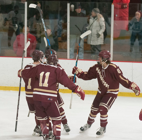 JIM VAIKNORAS/Staff photo Newburyport players celebrate their first goal against Triton at the Graf Rink in Newburyport Saturday.