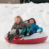 JIM VAIKNORAS/Staff photo Harper Bradshaw, 10, and Charlotte Wallace, 11, sled on the Bartlet Mall in Newburyport Saturday.