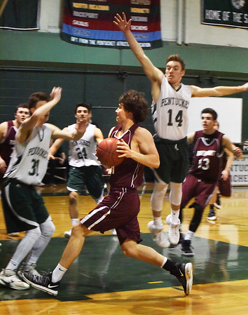 BRYAN EATON/Staff photo. Rockport's Benjamin Bradley moves into some Pentucket defense.