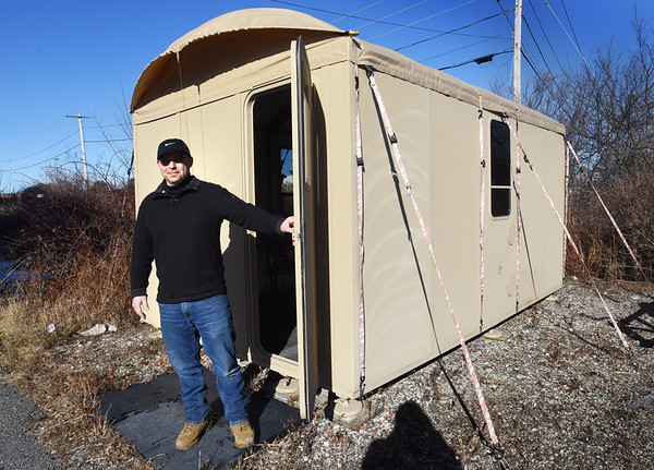 BRYAN EATON/Staff photo. Visible Good owner, John Rossi, shows a shelter that's is set up.