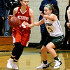 BRYAN EATON/Staff photo. Amesbury's Ashlee Porcaro gets pressure from Maddie Doyle.