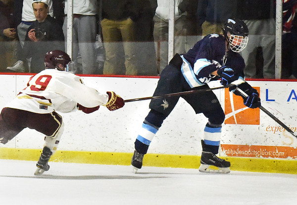 BRYAN EATON/Staff photo. Newburyport's Cole Spence moves in on Triton's Connor Kohan.