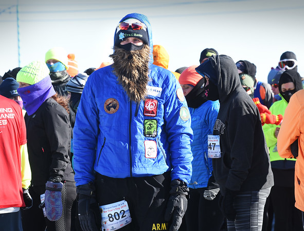 BRYAN EATON/Staff photo. Runners in the 5K and 10K Hangover classic bundled up against the extreme cold at Salisbury Beach yesterday.