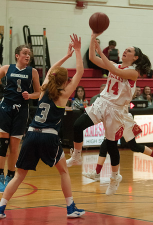JIM VAIKNORAS/Staff photo Amesbury's Ashlee Porcaro drives to the basket against Hamilton-Wenham at Amesbury Friday night.