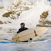 JIM VAIKNORAS/Staff photo Keenan Kealy braves the cold temperatures to surf off Salisbury beach Friday afternoon. At the time of the photo it was 14 degrees with a 20 MPH wind putting the wind chill at -4.