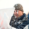 JIM VAIKNORAS/Staff photo   Donald Chapelle of Brilliant Ice Sculpture carves at the Old Newbury Christmas tree Bonfire at the Tendercrop Farm fields and Spencer Perce-Little Farm in Newbury Saturday night.<br /> <br /> ,
