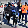 BRYAN EATON/Staff photo. Runners in the 10K Hangover Classic sponsored by the WInner's Circle Running Club head out yesterday morning. Some would jump into the 44 degree ocean at Salisbury Beach at the end of the race.