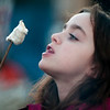 JIM VAIKNORAS/Staff photo Molly Burke, 10, of Groveland enjoys a toasted marshmallow at the Old Newbury Christmas tree Bonfire at the Tendercrop Farm fields and Spencer Perce-Little Farm in Newbury Saturday night.