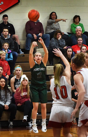 BRYAN EATON/Staff photo. Pentucket's Jess Galvin shoots for two, but falls short on this volley.