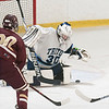 JIM VAIKNORAS/Staff photo Triton goalie Jamie Szmanski makes a save against Newburyport Saturday at the Graf Rink in Newburyport.