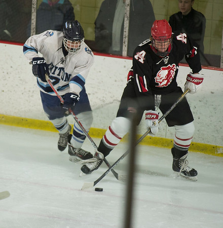 JIM VAIKNORAS/Staff photo Triton's Mike Beevers guards Amesbury's  Blake Bennett at the Graf Rink Wednesday night.