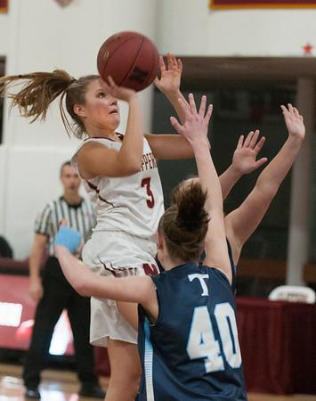 JIM VAIKNORAS/Staff photo Newburyport's Maggie Pons drives to the basket against Triton at Newburyport Friday night.