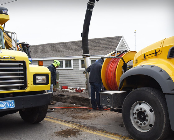 BRYAN EATON/Staff photo. Newburyport water department repairs a water main break in front of the old refurbished clam shack on Water Street on Monday. Traffic access was closed from Marlboro to just past past Beacon Avenue during the repair.