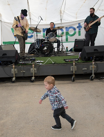 JIM VAIKNORAS/Staff photo Carson Vercollone, 2, of Bedford dances to the music of the Chuck Walker Trio at the WE=NBPT festival at the Tannery in Newburyprt Saturday.