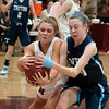 JIM VAIKNORAS/Staff photo Newburyport's Katelyn Hadden battle Triton's Emily Colby for a loose ball at Newburyport Friday night.