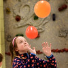 "BRYAN EATON/Staff photo. Madeline Taylor, 9, taps balloons in the game ""Keep It Up"" in Margaret Welch's physical education class at the Amesbury Elementary School as they work with eye to hand coordination. After this excercise the students played a game of floor hockey as they continued the theme."