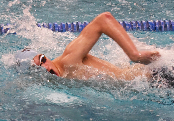 BRYAN EATON/Staff photo. Jared Picciano competes in the 100 yard freestyle swim.