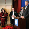 BRYAN EATON/Staff photo. Mayor Donna Holaday, left, listens a Governor Charlie Baker speaks at the inauguration.