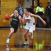BRYAN EATON/Staff photo. Pentucket's Angleina Yacubacci drives past Masconomet's Sara Fogarty.