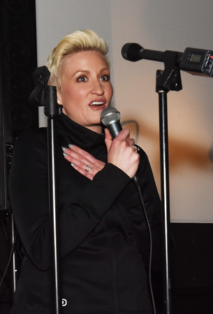 BRYAN EATON/Staff photo. Small Business Revolution's Amanda Brinkman speaks to the crowd at the Stage II Cinema Pub.